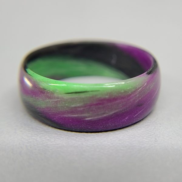green purple and black marble glow ring