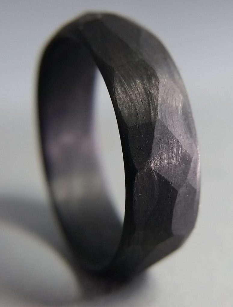 Carbon faceted ring