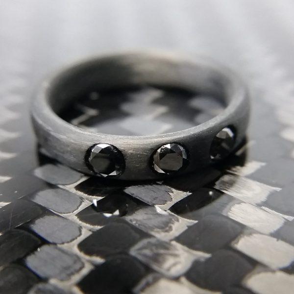 Carbon Fiber Ring with 3-3mm Black Diamonds